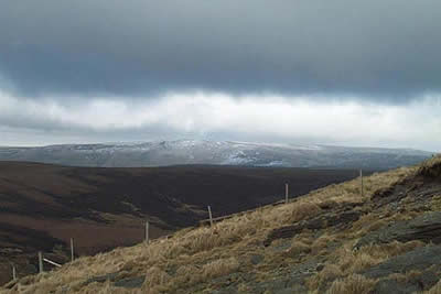 Storm clouds over a snowy Bleaklow