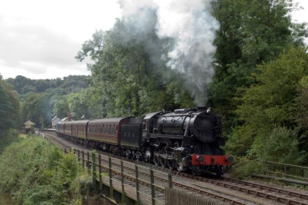 A steam train departs from Consall station