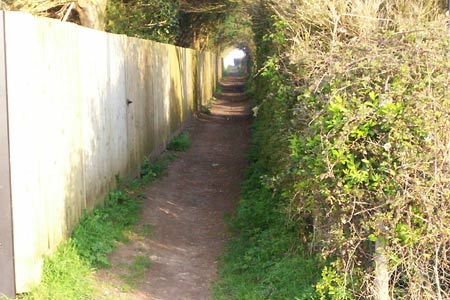 The narrow path from Mill Hill towards open downs