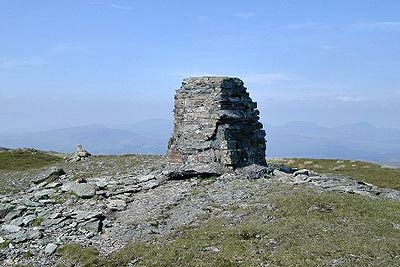 Summit cairn on Rhobell Fawr & view to Rinogs