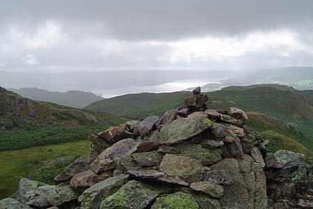 Summit cairn on Loughrigg with Windermere in the background